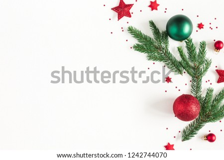 Christmas composition. Fir tree branches, red and green decorations on white background. Christmas, winter, new year concept. Flat lay, top view, copy space #1242744070
