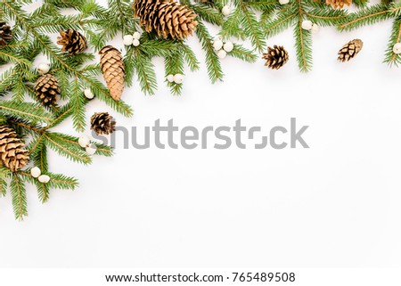 Christmas composition, frame boundaries with fir branches, pine cones on white background. Flat lay, top view #765489508