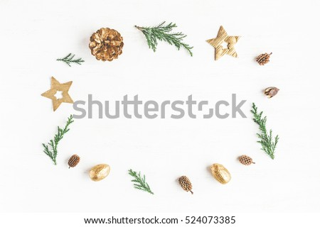 Christmas composition. Frame made of christmas decoration, cypress branches, pine cones. Flat lay, top view
