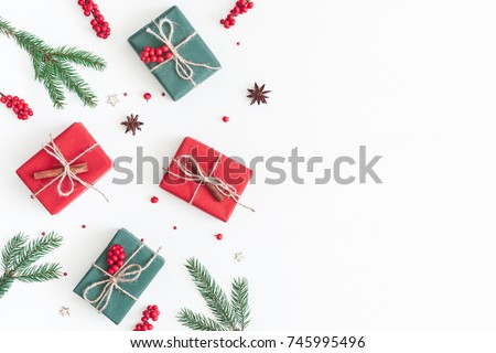 Christmas composition. Frame made of christmas gifts, pine branches, toys on white background. Flat lay, top view, copy space
