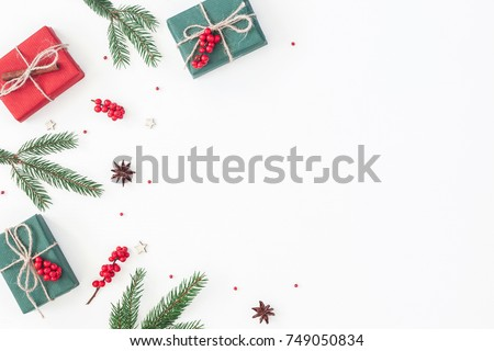 Christmas composition. Frame made of christmas gifts, pine branches, toys on white background. Flat lay, top view, copy space.