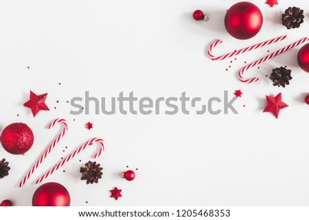 Christmas composition. Frame made of red decorations on pastel gray background. Christmas, winter, new year concept. Flat lay, top view, copy space #1205468353