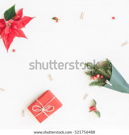 Christmas composition. Gift, bouquet made of traditional christmas plants. Flat lay, top view