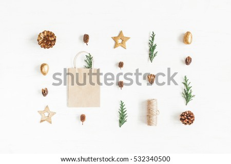 Christmas composition. Gift, christmas decoration, cypress branches, pine cones. Flat lay, top view.