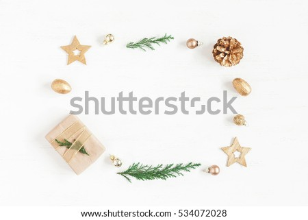 Christmas composition. Gift, christmas decoration, cypress branches, pine cones. Flat lay, top view