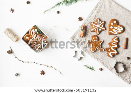 Christmas composition. Gift, larch branches, cinnamon sticks, anise star, christmas cookies. Flat lay, top view #503191132
