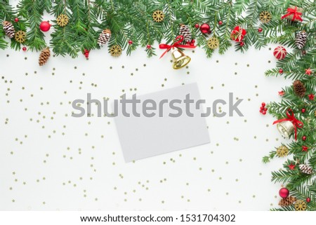 Christmas composition. Gift snowflake bauble star bauble envelope branch top view background with copy space for your text. Flat lay. #1531704302