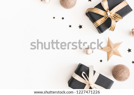 Christmas composition. Gifts, black and golden decorations on white background. Christmas, winter, new year concept. Flat lay, top view, copy space #1227471226