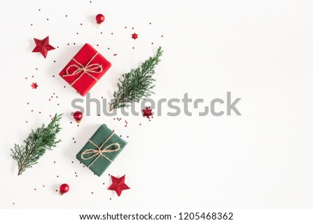 Christmas composition. Gifts, fir tree branches, red decorations on white background. Christmas, winter, new year concept. Flat lay, top view, copy space #1205468362
