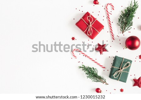 Christmas composition. Gifts, fir tree branches, red decorations on white background. Christmas, winter, new year concept. Flat lay, top view, copy space #1230015232