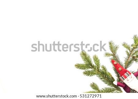 Christmas composition. Green fir twings and Xmas decoration Santa on white background. Top view, flat lay. Copy space for text #531272971