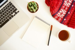 Christmas composition. Hot tea, empty notebook, laptop on white background. Christmas, winter, new year concept.