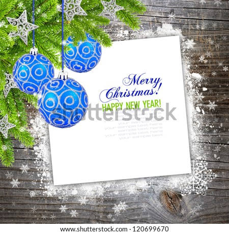 Christmas composition is on the sheet of paper on snowbound wooden background