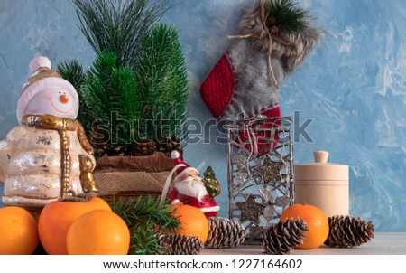 Christmas composition of Christmas objects with a Christmas tree and a snowman. New Year's decoration. Tangerines with persimmon. Christmas.