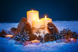 Christmas composition.Old metal lamps, white candles, silver snowflakes,spruce cones,figurines of stars.Blue and orange color toning.