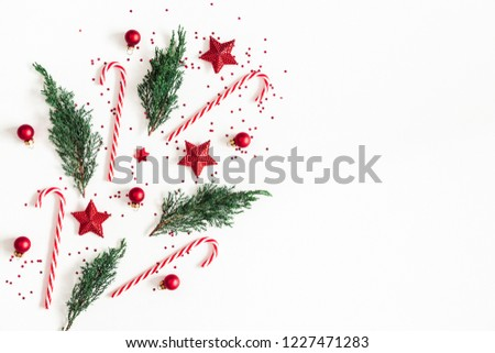 Christmas composition. Red decorations, fir tree branches on white background. Christmas, winter, new year concept. Flat lay, top view, copy space