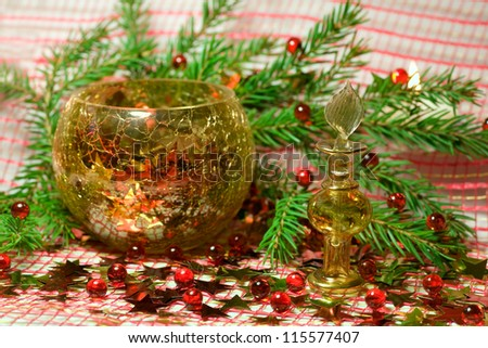 Christmas composition with  bottle,  stars  and branch of spruce