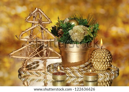 Christmas composition  with candles and decorations in gold color on bright background