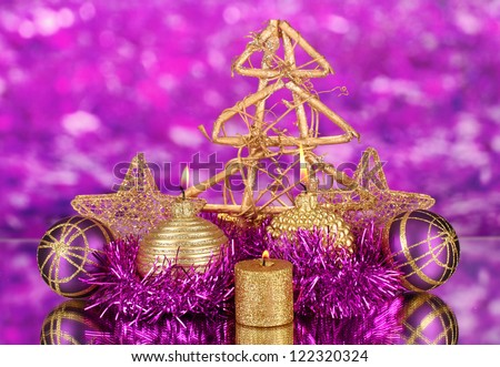 Christmas composition  with candles and decorations in purple and gold colors on bright background