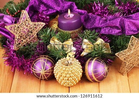 Christmas composition with candles and decorations in - Is purple a christmas color ...