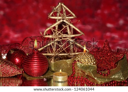 Christmas composition  with candles and decorations in red and gold colors on bright background