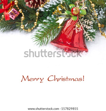 Christmas composition with fir branches, decorations and bell, isolated on white