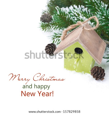 Christmas composition with fir branches, pine cones and birdhouse, isolated on white