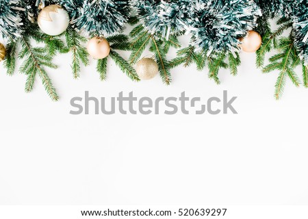 Christmas composition with fir branches, pine cones, christmas balls and tinsel. Flat lay, top view