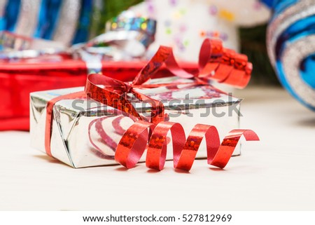 Christmas composition with gift box and decorations #527812969