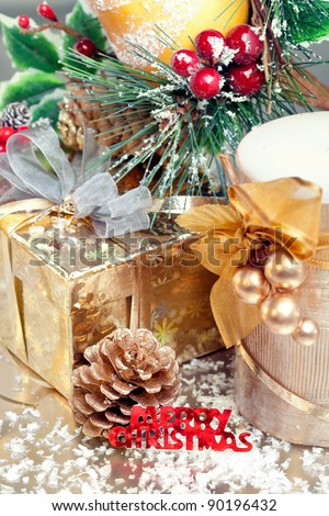 Christmas composition with gift box, candle and decorations, closeup shot, focus on the text