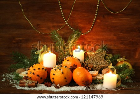 christmas composition with oranges and fir tree, on wooden background