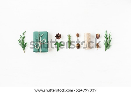 Christmas composition with pine cones, cypress branches, christmas gift. Top view, flat lay.