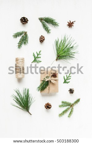 Christmas composition with pine cones, fir branches, christmas gift. Top view, flat lay