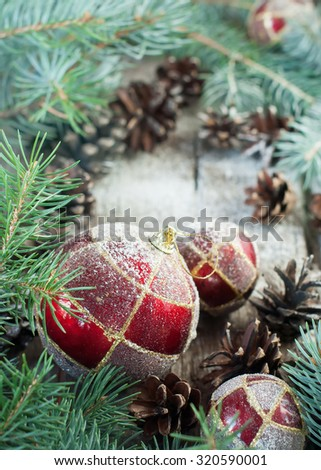 Christmas Composition with Red Balls, Pine Cones, Fir Tree on Wooden Background. Country style