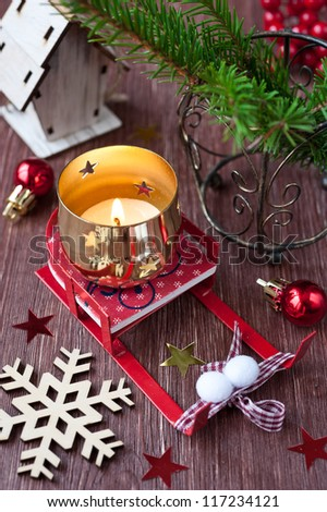 Christmas composition with sledges and candle
