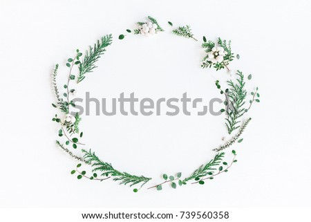 Christmas composition. Wreath made of winter plants, flowers, berries on white background. Christmas, winter, new year concept. Flat lay, top view, copy space
