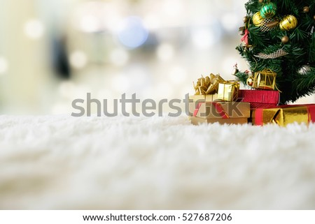 Christmas concept. Christmas decoration, Holiday decorations on snow with blur shopping center background. Soft focus,low light.(selective focus). #527687206