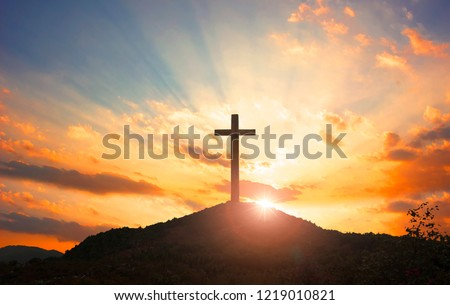Christmas concept: Crucifixion Of Jesus Christ Cross At Sunset #1219010821