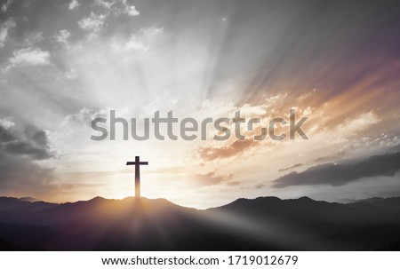 Photo of  Christmas concept: Crucifixion Of Jesus Christ Cross At Sunset