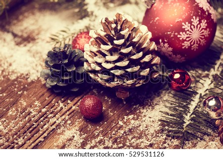 Christmas concept. Decorative tree next to decorations and craft supply. Selective focus