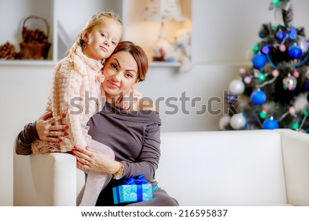 Christmas concept. happy mother and daughter in the room. give gifts