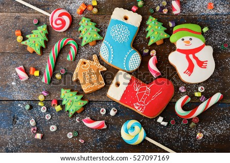 christmas cookie and candy on wood, food top view