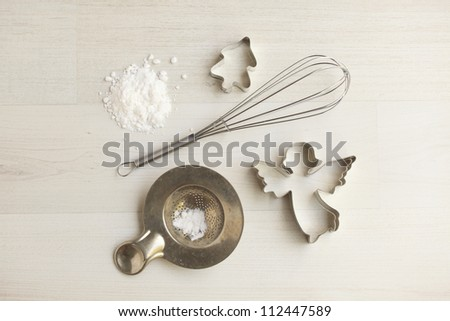 Christmas cookie cutters on wooden background