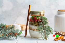 Christmas cookie mix jar. Dry ingredients for making Christmas cookies in a jar, white background.