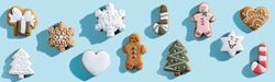 Christmas cookie pattern. Blue seamless background. Winter holidays dessert ornament. Gingerbread biscuit collection creative arrangement isolated on light.