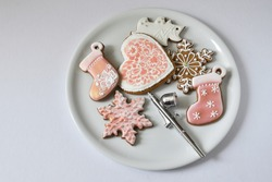 Christmas cookies and airbrush on a light plate.