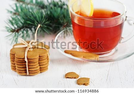 Christmas cookies and cup of tea with lemon