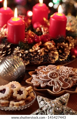 Christmas cookies and decorations on a table. Focus on girgerbread cookies