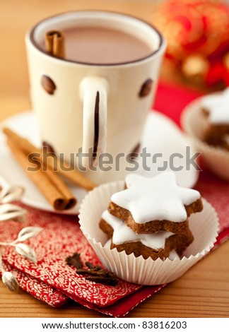Christmas cookies and hot chocolate with cinnamon