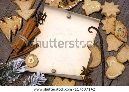 Christmas cookies and old vintage blank paper on wooden boards